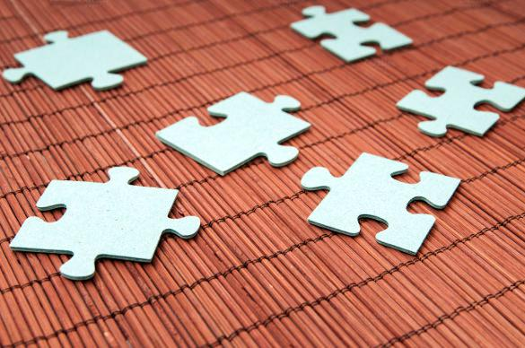 Puzzle Pieces On a Wooden Background